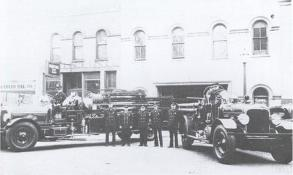 Early firefighters with fire engines